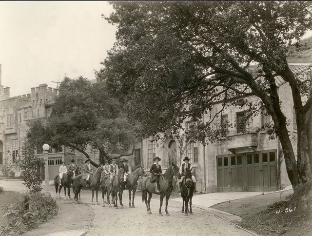Hollywoodland equestrians with steeds from the Sunset Ranch Stables , riding on Woodhaven Drive c.1925.